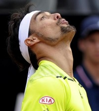 Italian tennis player Fabio Fognini reacts during the match against to Lukas Rosol of The Czech Republic during their first round match for the Italian Open tennis tournament at the Foro Italico in Rome, Italy, 12 May 2014. ANSA/CLAUDIO ONORATI