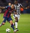 Barcelona's Brazilian defender Dani Alves (L) and Juventus' French midfielder Paul Pogba vie for the ball during the UEFA Champions League Final football match between Juventus and FC Barcelona at the Olympic Stadium in Berlin on June 6, 2015. AFP PHOTO / PATRIK STOLLARZ